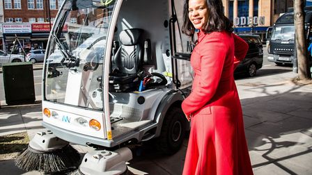 Cllr Claudia Webbe in a council PR shot with an all-electric street sweeper on trial in Holloway. Pi