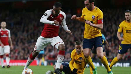 Alexandre Lacazette of Arsenal takes the ball into the area in the UEFA Europa League game between A