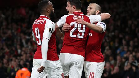 Arsenal's Alexandre Lacazette (left) celebrates scoring his side's first goal of the game with team-