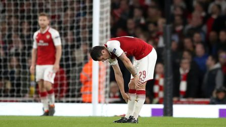 Arsenal's Granit Xhaka (right) looks dejected after seeing his side concede during the UEFA Europa L