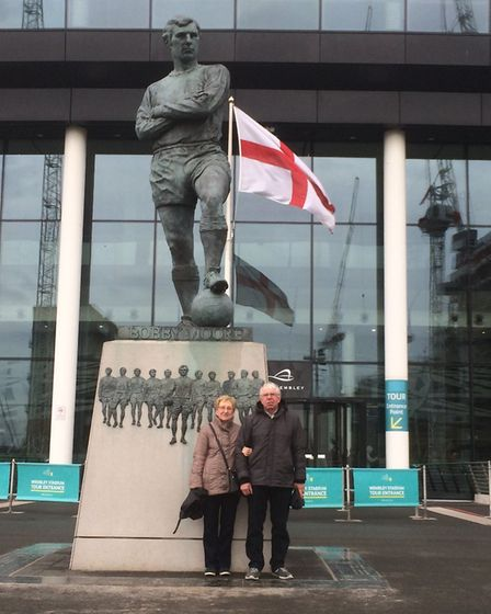 Tony and Maureen Jones by the Bobby Moore statue at Wembley. Picture: Lucas Cumiskey