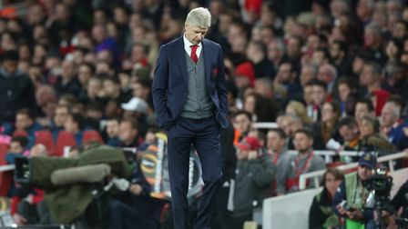 Arsenal manager Arsène Wenger looks dejected after his side concedes a late equaliser against a 10-m