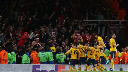 Antoine Griezmann of Atlético Madrid celebrates his equalising goal in front of the travelling Atlét