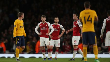Arsenal players look shell shocked after conceding a late equaliser against a 10-man Atlético Madrid