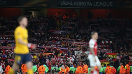 The travelling Atlético Madrid support celebrate a vital away goal in the UEFA Europa League game be