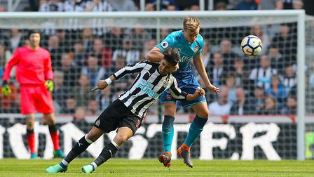 Newcastle United's Ayoze Perez (left) and Arsenal's Rob Holding battle for the ball (pic Owen Humphr