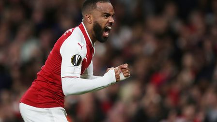 Alexandre Lacazette of Arsenal celebrates scoring the first goal in the UEFA Europa League game betw