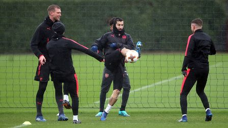 Arsenal's Henrikh Mkhitaryan (centre) with team-mates during a training session at London Colney (pi