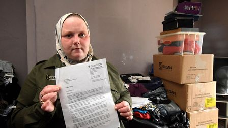 Jennifer Read, pictured with a letter from Islington Council, is forced to live in one room after a