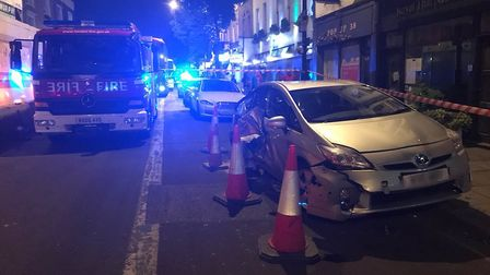 One of the damaged vehicles in Caledonian Road last night. Picture: Islington Police/Twitter (@MPSIs