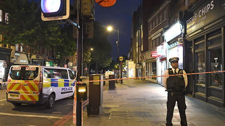 A cop at the scene of the stabbing in Upper Street last night. Picture: Victoria Jones/PA Wire