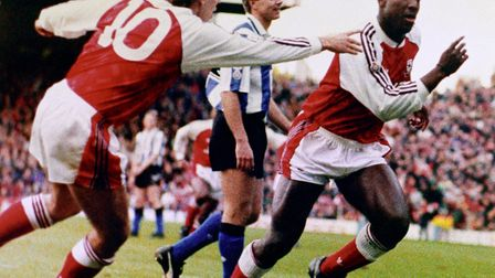 Arsenal's Paul Merson congratulates teammate Kevin Campbell on a goal (pic PA)