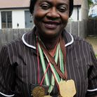 Matron Rose Amankwaah with her medals from her previous career.