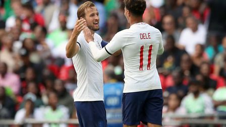 England's Harry Kane (left) celebrates scoring his side's second goal of the game with Dele Alli dur
