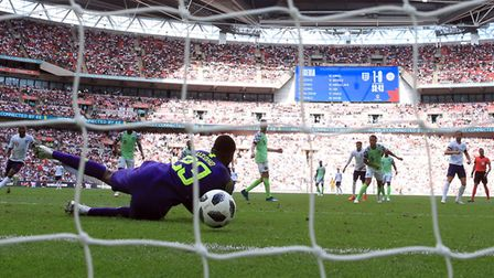 England's Harry Kane (second right) scores his side's second goal of the game during the Internation