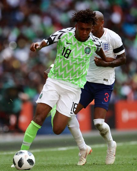 Nigeria's Alex Iwobi (left) and England's Ashley Young battle for the ball during the International