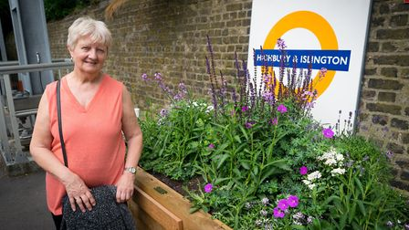 Bill Little's sister Pauline Smith next to the planter in Highbury and Islington station. Picture: S