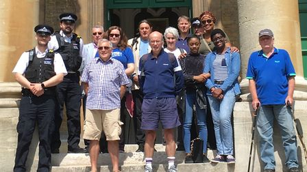 Volunteers gather outside St Mellitus Church ahead of a knife sweep in Wray Crescent. Picture: Sonia