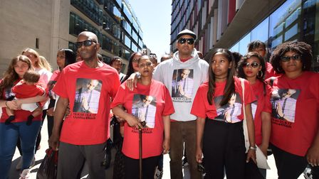Family and friends of Nashon Esbrand outside the Old Bailey this afternoon, after the sentencing of