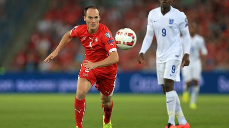 Stephan Lichtsteiner in action for Switzerland against England, as Danny Welbeck looks on (pic Mike