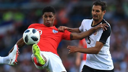 England's Marcus Rashford (left) and Costa Rica's Celso Borges battle for the ball during the Intern
