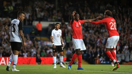 England's Danny Welbeck (centre) celebrates scoring his side's second goal against Costa Rica with t
