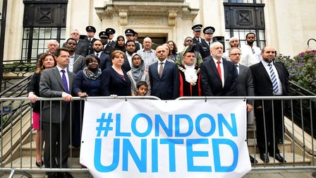 Politicians, faith leaders and community leaders at the steps of Islington Town Hall to mark a year