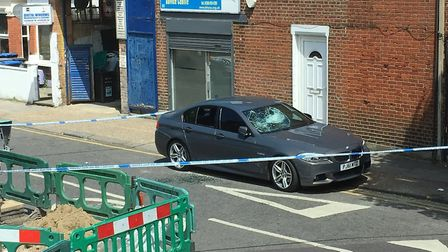 A car windscreen was smashed in the road. Picture: Annika McQueen