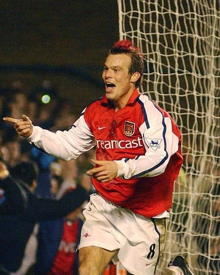 Arsenal's Fredrik Ljungberg with his famous red hair. PA