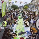 A general view as hundred sit and eat during a street iftar outside of Finsbury Park Mosque. Picture