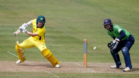 Middlesex wicketkeeper Robbie White looks on from behind the stumps as Australia's Travis Head hits