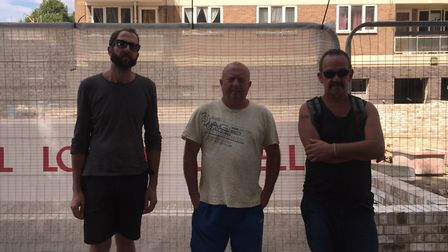 A site foreman and two bricklayers on the Dover Court Estate. Picture: Lucas Cumiskey