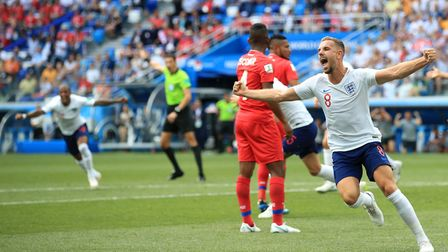 England's Jordan Henderson celebrates Johns Stones' first goal of the game during the FIFA World Cup