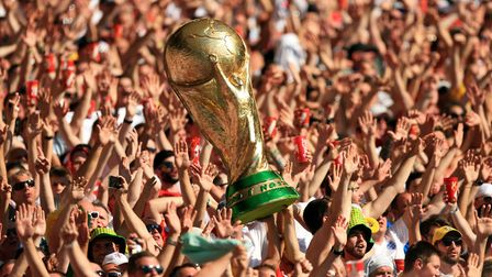 England fans hold up a giant replica World Cup trophy in the stands