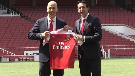 New Arsenal manager Unai Emery (right) with chief executive Ivan Gazidis on the pitch after a press