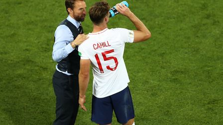 England manager Gareth Southgate (left) speaks with Gary Cahill during the FIFA World Cup Group G ma
