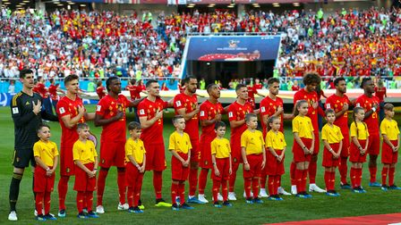 The Belgium team line up with the mascots before the FIFA World Cup Group G match at Kaliningrad Sta
