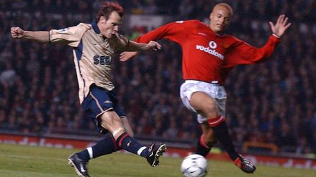 Freddie Ljungberg of Arsenal fires in his shot past Wes Brown of Manchester United that set Sylvain