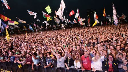 Fans watch Foo Fighters perform My Hero on The Pyramid Stage at the Glastonbury Festival, at Worthy