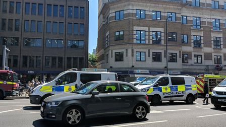 Police outside Angel station this afternoon. Picture: Helen Leathem