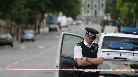 A police officer stands by a cordon at the end of North Road on June 29, 2008,close to the scene whe