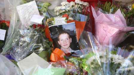 Flowers left at the scene in 2008 where Ben Kinsella was murdered. Picture: Dominic Lipinski/PA