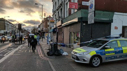 Cops at the scene of the killing in Seven Sisters Road the day after. Picture: submitted to Islingto