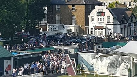 T20 cricket fans queue outside the North Gate at Lord's between Middlesex hosted Surrey. CREDIT @lay