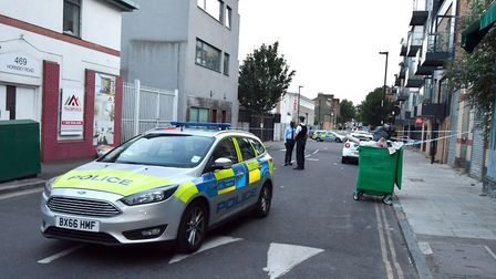 Police at the scene of the stabbing in Fairbridge Road last night. Picture: John Stillwell/PA Wire