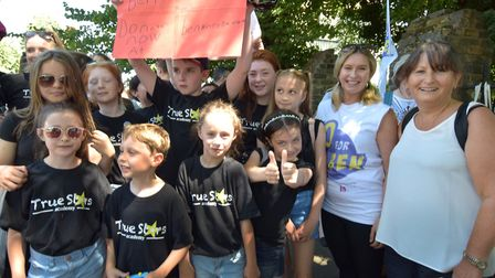 Brooke Kinsella joins children from her True Stars Academy on Colebrooke Row at the start of the cha