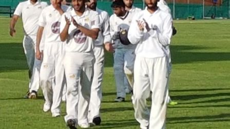 Crouch End players leave the pitch (pic: Crouch End CC).