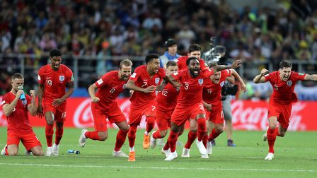 England celebrate winning the penalty shootout against Colombia. Photo: Owen Humphreys / PA