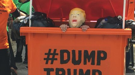 A #DUMPTRUMP bin at the protest. Picture: Lucas Cumiskey