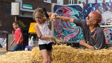 A hay fight at the Whitecross Street Party on Sunday. Picture: Siorna Ashby